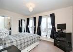 Master bedroom with 'Juliet' style balconies