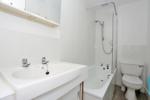 Bathroom with an overbath shower