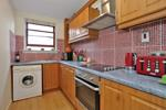 Modern kitchen with white goods included