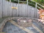 Seating area with focal fire pit alt angle