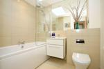 Luxury bathroom with overbath shower