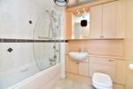 Bathroom with an overbath shower
